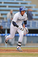 Asheville Tourists catcher Jose Briceno #4 runs to first during game one of a double header against the West Virginia Power at McCormick Field on April 8, 2014 in Asheville, North Carolina. The Power defeated the Tourists 6-5. (Tony Farlow/Four Seam Images)