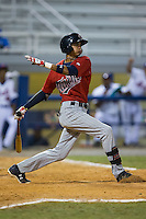 Nelson Molina (12) of the Elizabethton Twins follows through on his swing against the Kingsport Mets at Hunter Wright Stadium on July 9, 2015 in Kingsport, Tennessee.  The Twins defeated the Mets 9-7 in 11 innings. (Brian Westerholt/Four Seam Images)