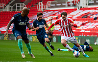 20th March 2021; Bet365 Stadium, Stoke, Staffordshire, England; English Football League Championship Football, Stoke City versus Derby County; Nick Powell of Stoke City under pressure from  Graeme Shinnie of Derby County