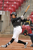 Quad Cities River Bandits shortstop Jeremy Pena (1) swings at a pitch against the Cedar Rapids Kernels at Veterans Memorial Stadium on April 15, 2019 in Cedar Rapids, Iowa.  The River Bandits won 7-2.  (Dennis Hubbard/Four Seam Images)