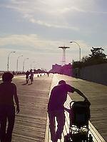 People strolling Coney Island boardwalk<br />
