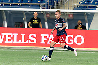 FOXBOROUGH, MA - AUGUST 29: Alexander Buttner #28 of New England Revolution dribbles during a game between New York Red Bulls and New England Revolution at Gillette Stadium on August 29, 2020 in Foxborough, Massachusetts.