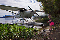 A young visitor to the Clear Lake Seaplane Splash-In, Lakeport, Lake County, California admires this Silvaire Luscombe 8E on floats, N1857K.