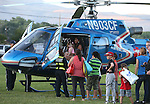 Residents tour a Careflight helicopter during the 14th annual National Night Out in Carson City, Nev., on Tuesday, Aug. 2, 2016. <br />