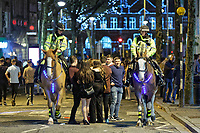 Pictured: Two mounted police officers patrol Wind Street, Swansea. Monday 31 December 2018 and Tuesday 01 January 2019<br /> Re: New Year revellers in Wind Street, Swansea, Wales, UK