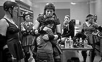 """""""Kimfectious"""" hugs her team captain as the San Francisco ShEvil Dead compete against the Richmond Wrecking Belles at Fort Mason Center in San Francisco, CA on March 14, 2009."""