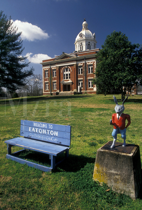 AJ3967, Eatonton, Georgia, Blue bench and statue of Br'er Rabbit (favorite fictional children's character) on Courthouse Square in front of the Courthouse in Eatonton in the state of Georgia.