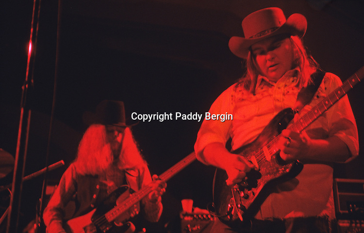 """Bassist Leon Wilkeson and guitarist Ed King, Lynyrd Skynyrd, Dome Brighton 1974.<br /> <br /> Lynyrd Skynyrd is an American rock band best known for popularising the southern hard-rock genre during the 1970s.<br /> <br /> The band rose to worldwide recognition on the basis of its driving live performances and signature tunes """"Sweet Home Alabama"""" and """"Free Bird"""". At the peak of their success, three members died in an airplane crash in 1977, putting an abrupt end to the band's most popular incarnation.<br /> <br /> Stock Photo by Paddy Bergin"""