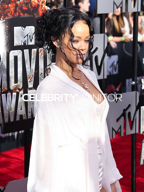 LOS ANGELES, CA, USA - APRIL 13: Singer Rihanna wearing Ulyana Sergeenko arrives at the 2014 MTV Movie Awards held at Nokia Theatre L.A. Live on April 13, 2014 in Los Angeles, California, United States. (Photo by Xavier Collin/Celebrity Monitor)