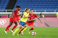 YOKOHAMA, JAPAN - AUGUST 6: Kosovare Asllani #9 of Sweden and Julia Grosso #7 of Canada battle for the ball during a game between Canada and Sweden at International Stadium Yokohama on August 6, 2021 in Yokohama, Japan.