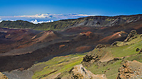 The Big Island of Hawaii is visible in the background of this panoramic view of the crater in HALEAKALA NATIONAL PARK on Maui in Hawaii