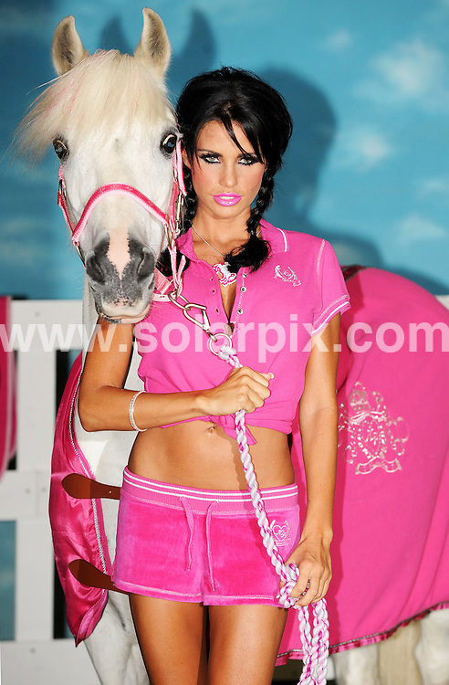 **ALL ROUND PICTURES FROM SOLARPIX.COM**.**WORLDWIDE SYNDICATION RIGHTS**.Top Glamour model Katie price alias Jordan,launched KP Equestrian her first horse riding range of clothing and accessories which includes boots whips and skimpy sexy shorts in bright colours...JOB REF:7189-SSD     DATE:03_09_08.**MUST CREDIT SOLARPIX.COM OR DOUBLE FEE WILL BE CHARGED* *UNDER NO CIRCUMSTANCES IS THIS IMAGE TO BE REPRODUCED FOR ANY ONLINE EDITION WITHOUT PRIOR PERMISSION*