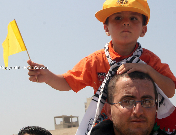 """Palestinian Fatah supporters attend Friday prayers in Gaza August.31.2007""""photo by Fady Adwan"""""""