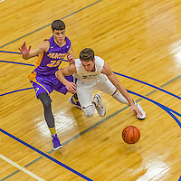 22 November 2015: Yeshiva University Maccabee Guard Shaje Weiss, a Senior from Edison, NJ, drives to the basket in the second half of play against the Hunter College Hawks at the Max Stern Athletic Center  in New York, NY. The Maccabees defeated the Hawks 81-71 in non-conference play, for their second win of the season. Mandatory Credit: Ed Wolfstein Photo *** RAW (NEF) Image File Available ***