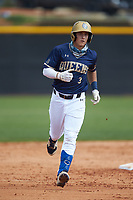 Riley Cheek (3) of the Queens Royals rounds the bases after hitting a home run against the Catawba Indians during game one of a double-header at Tuckaseegee Dream Fields on March 26, 2021 in Kannapolis, North Carolina. (Brian Westerholt/Four Seam Images)