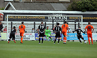 Pictured: Chris Jones of Neath (7) opening the score with a penalty shot, Thorsten Stuckman goalkeeper for Swansea (in green) fails to save the ball. Saturday 17 July 2011<br /> Re: Pre season friendly, Neath Football Club v Swansea City FC at the Gnoll ground, Neath, south Wales.