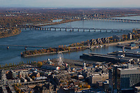 aerial photograph of La Grande Roue de Montréal ferris wheel and vicinity, Montreal, Quebec, Canada;City de Havre peninsula and Saint Lawrence River in the background photographie aérienne d'un porte-conteneurs s'approchant de l'île Sainte-Hélène sur le fleuve Saint-Laurent, Montréal, Québec, Canada