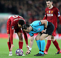 Referee Danny Makkelie applies vanishing spray ahead of a free-kick to be taken by Liverpool's Trent Alexander-Arnold<br /> <br /> Photographer Rich Linley/CameraSport<br /> <br /> UEFA Champions League Round of 16 Second Leg - Liverpool v Atletico Madrid - Wednesday 11th March 2020 - Anfield - Liverpool<br />  <br /> World Copyright © 2020 CameraSport. All rights reserved. 43 Linden Ave. Countesthorpe. Leicester. England. LE8 5PG - Tel: +44 (0) 116 277 4147 - admin@camerasport.com - www.camerasport.com