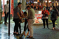 Pictured: A woman is helped to her feet by two men in Wind Street, Swansea, Wales, UK. Friday 20 December 2019<br /> Re: Black Eye Friday (also known as Black Friday, Mad Friday, Frantic Friday) the last Friday before Christmas, in Swansea, Wales, UK.