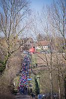 Peloton during the 1st passage over the Haaghoek cobbles<br /> <br /> 73th Omloop Het Nieuwsblad 2018<br /> Gent-Meerbeke (BEL) - 196km