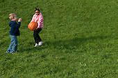 MR / Schenectady, NY. Boy (6) claps as girl (6, African-American) carries pumpkin. MR: Lus1, Joh18. ID: AK-ICP. © Ellen B. Senisi