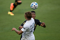 LOS ANGELES, CA - AUGUST 22: Rolf Feltscher #25 of Los Angeles Galaxy heads a ball during a game between Los Angeles Galaxy and Los Angeles FC at Banc of California Stadium on August 22, 2020 in Los Angeles, California.
