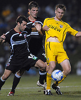 U.S. Open Cup Round of 16: Crew's Eddie Gaven (12) controls the ball and is defended by United's Ben Olsen (14) and Bobby Boswell (32). DC United defeated the Columbus Crew in overtime 2-1. Tuesday, August 1, 2006, at Maryland Soccerplex.