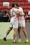 Harry Glover and Will Glover celebrate at the conclusion of the match Australia vs England, the Bronze Final of Day 2 of the HSBC Singapore Rugby Sevens as part of the World Rugby HSBC World Rugby Sevens Series 2016-17 at the National Stadium on 16 April 2017 in Singapore. Photo by Victor Fraile / Power Sport Images