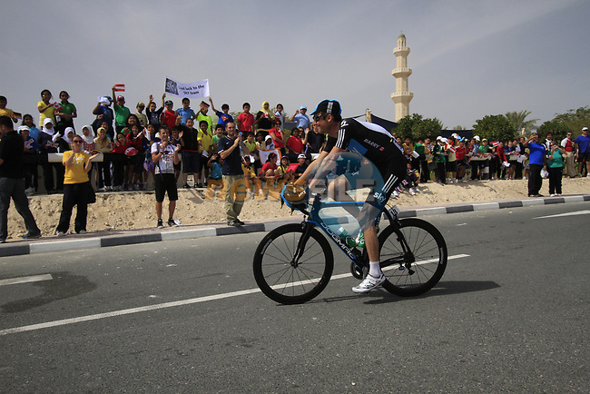 Sky Procycling team rider Michael Barry (CAN) passes local school children before the start of the 3rd Stage of the 2012 Tour of Qatar running 146.5km from Dukhan Souq, Dukhan to Al Gharafa, Qatar. 7th February 2012.<br /> (Photo Eoin Clarke/Newsfile)
