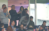 Rita Mahrez, wife of Riyad looks on something on the phone of Wayne Lineker during the Barclays Premier League match between Leicester City and Swansea City played at The King Power Stadium, Leicester on 24th April 2016