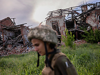 A soldier passes by a destroyed building in the frontline city of Pisky, located in the outskirts of Donetsk, the stronghold of the Russian-backed separatists. Not a single house in the town stands untouched by the war. According to the Ukranian govenment soldiers based here, not a day goes by without attacks from the separatist forces, either from snipers or shelling.