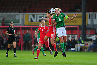 Angharad James of Wales battles with Ashley Hutton of Northern Ireland during the UEFA Womens Euro Qualifier match between Wales and Northern Ireland at Rodney Parade in Newport, Wales, UK. Tuesday 03, September 2019