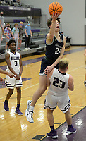 Bentonville West's Jack Farnsworth (24) reaches to score Tuesday, Jan. 5, 2021, Fayetteville's Kaiden Turner (23) attempts to draw a charge during the first half of play in Bulldog Arena in Fayetteville. Visit nwaonline.com/210106Daily/ for today's photo gallery. <br /> (NWA Democrat-Gazette/Andy Shupe)