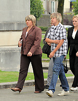 Pictured: The mother of Joshua Davies Hayley (L), with a young man believed to be his brother (R) arriving at Swansea Crown Court. Friday 02 September 2011<br />