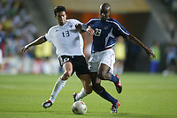 Michael Ballack and Eddie Pope fight for a 50/50 ball. The USA lost to Germany 1-0 in the Quarterfinals of the FIFA World Cup 2002 in South Korea on June 21, 2002.