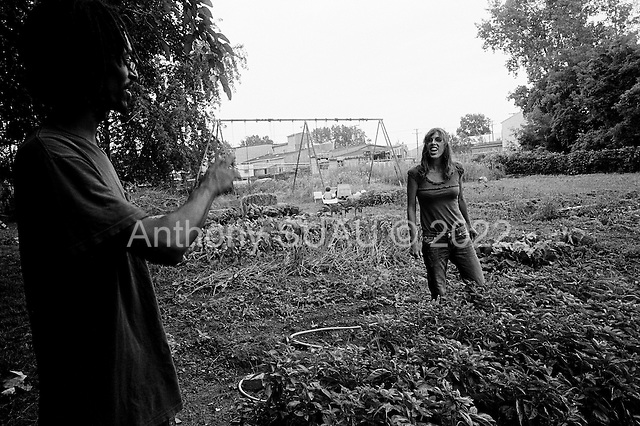 Detroit, Michigan<br /> USA<br /> July 20, 2010<br /> <br /> William Gardner and his wife Kelly are two of many who have turned Detroit's vacant lots into urban gardens. William has been working his garden to 2 years now and has managed to farm 8 lots with vegetables and herbs and provide food for his family and neighbors. He also sells his vegetables and his wife's herbs at the Saturday farmer's market. They are raising two young children and have chickens, goats and ducks as well. Urban gardening has taken Detroit by storm with so many vacant lots open after homes were foreclosed, abandoned and demolished.