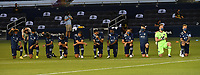KANSAS CITY, KS - OCTOBER 07: Sporting KC starting XI take a knee during the national anthem before the game between Chicago Fire and Sporting Kansas City at Children's Mercy Park on October 07, 2020 in Kansas City, Kansas.