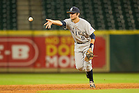 Christian Stringer #5 of the Rice Owls flips the baseball towards second base during the game against the Tennessee Volunteers at Minute Maid Park on March 4, 2012 in Houston, Texas.  The Owls defeated the Volunteers 11-1.  Brian Westerholt / Four Seam Images