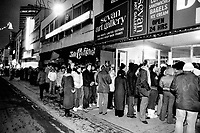 Bargain hunters galore: Scores of people climbed out of bed long before dawn today to be sure of grabbing Boxing Day bargains at a leather goods store on downtown Yonge St. Those at the head of the line-up had been there since 1 a.m. when the store opened at 6.45. Other stores across Metro; most of them opening for the first time since Thursday; braced for the annual onslaught; which could be a wilder affair than ever as the crunch of rising prices makes shoppers more bargain-conscious than ever.<br /> <br /> Date Unknown