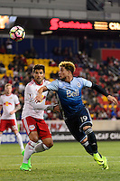 Harrison, NJ - Wednesday Feb. 22, 2017: Salvatore Zizzo, Erik Hurtado during a Scotiabank CONCACAF Champions League quarterfinal match between the New York Red Bulls and the Vancouver Whitecaps FC at Red Bull Arena.