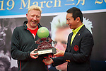 Mission Hills Vice Chairman Tenniel Chu (right) offers a trophy to tennis legend Boris Becker (leftt) during the press conference for the opening of Boris Becker Tennis Academy at Mission Hills Resort on 19 March 2016, in Shenzhen, China. Photo by Lucas Schifres / Power Sport Images