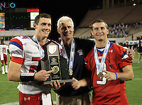 Manatee Hurricanes quarterback Cord Sandberg #24, brother Chase Sandberg #9 - who did not play due to injury - pose with their father Chuck Sandberg (center) after the Florida High School Athletic Association 7A Championship Game at Florida's Citrus Bowl on December 16, 2011 in Orlando, Florida.  Manatee defeated First Coast 40-0.  (Mike Janes/Four Seam Images)