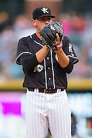Charlotte Knights starting pitcher Chris Beck (16) looks to his catcher for the sign against the Pawtucket Red Sox at BB&T Ballpark on August 9, 2014 in Charlotte, North Carolina.  The Red Sox defeated the Knights  5-2.  (Brian Westerholt/Four Seam Images)