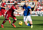 Aberdeen v St Johnstone…18.09.21  Pittodrie    SPFL<br />Chris Kane battles with David Bates<br />Picture by Graeme Hart.<br />Copyright Perthshire Picture Agency<br />Tel: 01738 623350  Mobile: 07990 594431