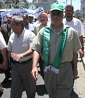 "Supporters of the Hamas movement of trade unions in solidarity with Prime Minister Ismail Haniya, the article denounced the decisions of Palestinian President Mahmoud Abbas to separate the West Bank from the Gaza Strip, June 24, 2007 .""phot by Fady Adwan"""