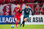 Wu Lei (l) of Shangahi SIPG FC fights for the ball with Hiromichi Katano of Sukhothai FC during their AFC Champions League 2017 Playoff Stage match between Shanghai SIPG FC (CHN) and Sukhothai FC (THA) at the Shanghai Stadium, on 07 February 2017 in Shanghai, China. Photo by Marcio Rodrigo Machado / Power Sport Images