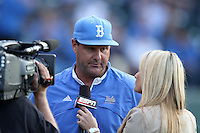 UCLA Bruins Head Coach John Savage #22 is interviewed during a game against the TCU Horned Frogs at the Los Angeles super regionals at Jackie Robinson Stadium on June 9, 2012 in Los Angeles,California. UCLA defeated TCU 4-1.(Larry Goren/Four Seam Images)
