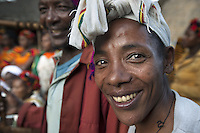 Ethiopia. Southern Nations, Nationalities, and Peoples' Region. Omo Valley. Hayzo Village. High altitude: 2800 meters. Dorze tribe. A smiling woman. The Dorze are a small ethnic group inhabiting the Gamo Gofa Zone who speak the Dorze language, an Omotic tongue. The Dorze are predominantly agriculturalists living in permanent villages. Well known cotton weavers, the Dorze tribe were once warriors. The Dorze numbered 40'000 reside in villages near the cities of Chencha and Arba Minch. Southern Nations, Nationalities, and Peoples' Region (often abbreviated as SNNPR) is one of the nine ethnic divisions of Ethiopia. 5.11.15 © 2015 Didier Ruef