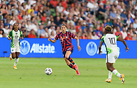 AUSTIN, TX - JUNE 16: Christen Press #23 of the United States brings the ball up the field between two Nigerian players during a game between Nigeria and USWNT at Q2 Stadium on June 16, 2021 in Austin, Texas.