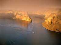 Sunrise with fog and boats on Lake Billy Chinook, Oregon
